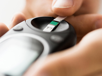 Patient checking blood sugar reading
